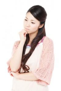 Beautiful young woman wearing an apron. Portrait of asian.